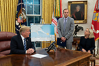 United States President Donald J. Trump participates in a meeting on Hurricane Florence with Federal Emergency Management Agency Director Brock Long and Department of Homeland Security Secretary Kirstjen Nielsen at The White House in Washington, DC,  September 11, 2018. <br /> CAP/MPI/RS<br /> &copy;RS/MPI/Capital Pictures