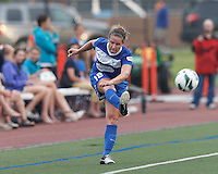 Boston Breakers defender Maddy Evans (18) crosses the ball.  In a National Women's Soccer League (NWSL) match, Seattle Reign FC (white) defeated Boston Breakers (blue), 2-1, at Dilboy Stadium on June 26, 2013.