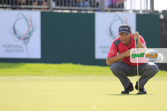 Padraig Harrington (IRL) lines up his putt on the 9th green during Saturday's Round 3 of the 2016 Portugal Masters held at the Oceanico Victoria Golf Course, Vilamoura, Algarve, Portugal. 22nd October 2016.<br /> Picture: Eoin Clarke | Golffile<br /> <br /> <br /> All photos usage must carry mandatory copyright credit (&copy; Golffile | Eoin Clarke)