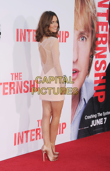 Rose Byrne<br /> at the Los Angeles Premiere of &quot;The Internship&quot; at Regency Village Theatre in Westwood, California, USA, May 29th, 2013.<br /> full length beige cream sheer dress long sleeve  silk satin shoes nude cut out back over shoulder behind <br /> CAP/ROT/TM<br /> &copy;Tony Michaels/Roth Stock/Capital Pictures