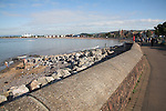 Rock armour on beach, sea wall and promenade, Minehead, Somerset, England