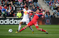 Chicago defender Austin Berry (22) slide tackles the ball away from New York forward Tim Cahill (17).  The Chicago Fire defeated the New York Red Bulls 3-1 at Toyota Park in Bridgeview, IL on April 7, 2013.