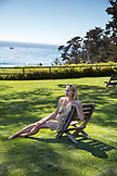 USA, California, Big Sur, Esalen, a woman sits on a chair in front of the Pacific Ocean, the Esalen Institute