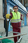 A street cleaner employed by private contractors Onyx in Camden Town, London.