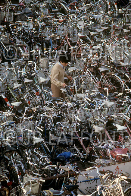 October, 1980. Tokyo, Japan. This is a typical bicycle parking lot, outside the train station near Tokyo. In 1980 the police department of Tokyo reported 7 bicycles stolen.
