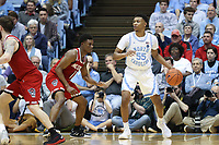 CHAPEL HILL, NC - FEBRUARY 25: Christian Keeling #55 of the University of North Carolina is guarded by Markell Johnson #11 of North Carolina State University during a game between NC State and North Carolina at Dean E. Smith Center on February 25, 2020 in Chapel Hill, North Carolina.