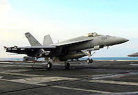 Recovering an F/A-18E Super Hornet aboard USS Abraham Lincoln.