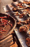 A hot tropical climate has the benefit of being used to dry foods. Pentax Spotmatic film camera. 2004