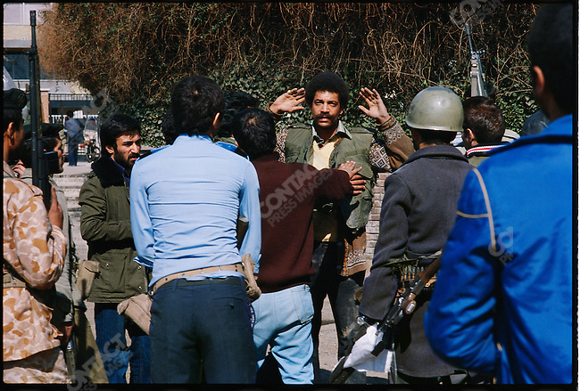 An American taken prisoner during the attack on the U.S. Embassy. Tehran, February 14, 1979