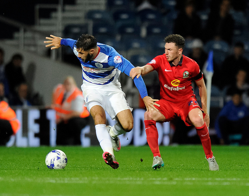 Blackburn Rovers' Corry Evans battles for possession with Queens Park Rangers' Charlie Austin<br /> <br /> Photographer Ashley Western/CameraSport<br /> <br /> Football - The Football League Sky Bet Championship - Queens Park Rangers v Blackburn Rovers - Wednesday 16th September 2015 - Loftus Road - London <br /> <br /> &copy; CameraSport - 43 Linden Ave. Countesthorpe. Leicester. England. LE8 5PG - Tel: +44 (0) 116 277 4147 - admin@camerasport.com - www.camerasport.com