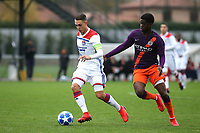 Maxence Caqueret of Olympique Lyonnais shields the ball from Manchester City's Taylor Richards during Lyon Under-19 vs Manchester City Under-19, UEFA Youth League Football at Groupama OL Academy on 27th November 2018