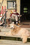 Super's Junkin Company. Proprietor and golden retriever dog on porch.