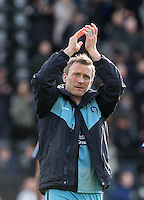 Garry Thompson of Wycombe Wanderers applauds the support during the Sky Bet League 2 match between Notts County and Wycombe Wanderers at Meadow Lane, Nottingham, England on 28 March 2016. Photo by Andy Rowland.