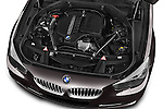 Car Stock 2016 BMW 5 Series 535i Gran Turismo Luxury Line 5 Door Hatchback Engine  high angle detail view