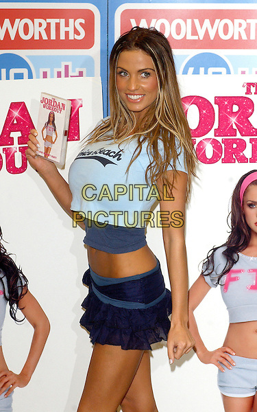 "JORDAN - KATIE PRICE .Signs copies of her new dvd ""The Jordan Workout"" At  Woolworths, Lakeside Shopping Centre, West Thurrock, Essex, UK.January 5th, 2006.Ref: BEL.full length blue shirt ruffle mini skirt.www.capitalpictures.com.sales@capitalpictures.com.© Capital Pictures."