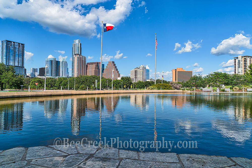 Our latest Austin skyline from this location on a beautiful blue sky day across the reflecting pool of water.  I really liked the reflection of the downtown buildings, and the blue sky and clouds that reflected back into this pool of water.  It was one of those perfect blue skies and puffy white cloud days that we were lucky enough to be here for. Austin skyline has been changing radically over the last five or so years that it has been hard to get a image without twenty or more cranes it.  For now thing have slowed down in this area enough to come back and capture a photo only because there is no more room to build anything at least for now.