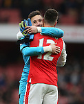 Arsenal's Olivier Giroud hugs Tottenham's Hugo Lloris at the final whistle during the Premier League match at the Emirates Stadium, London. Picture date November 6th, 2016 Pic David Klein/Sportimage