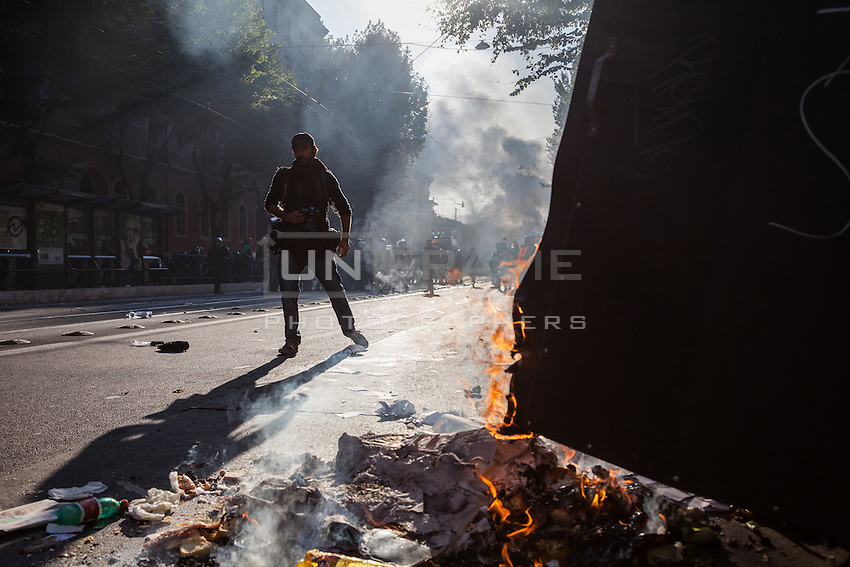 A press photographers reporting during the manifestation of the Italian Indignados that turned into a violent guerrilla. Rome, Italy. Oct. 15, 2011. (Photo by Riccardo Budini / UnFrame)