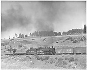 Engineer side view of K-37 #494 pushing east 113 extra powered by K-37 #493 &amp; #497 near Cumbres Pass below Cresco.<br /> D&amp;RGW  Cresco, CO  Taken by Kindig, Richard H. - 9/18/1952