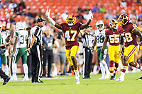 Landover, MD - August 16, 2018: Washington Redskins cornerback Prince Charles Iworah (47) celebrates an interception during preseason game between the New York Jets and Washington Redskins at FedEx Field in Landover, MD. (Photo by Phillip Peters/Media Images International)