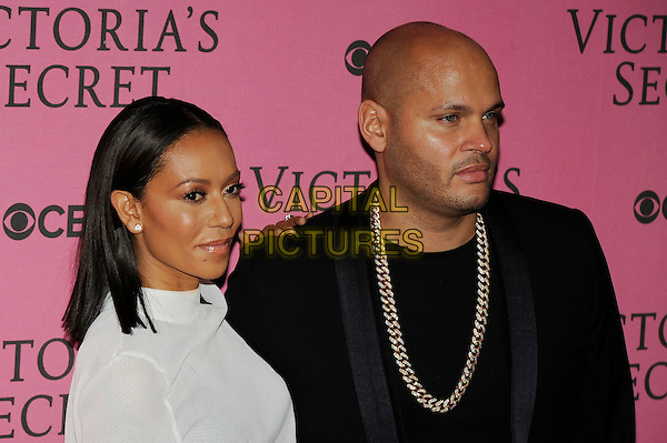 LONDON, ENGLAND - DECEMBER 2: Melanie Brown and Stephen Belafonte attend the pink carpet for Victoria's Secret Fashion Show 2014, Earls Court on December 2, 2014 in London, England.<br /> CAP/MAR<br /> &copy; Martin Harris/Capital Pictures