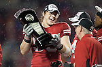 Wisconsin Badgers defensive lineman Patrick Butrym (95) holds the Leaders Division Trophy after an NCAA Big Ten Conference college football game against the Penn State Nittany Lions on November 26, 2011 in Madison, Wisconsin. The Badgers won 45-7. (Photo by David Stluka)