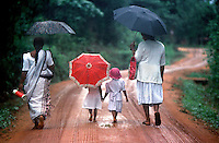Young, barefoot girls in Sri Lanka hold hands as their mom's walk them home from school. I made this image while retracing Mark Twain's journey around the world exactly 100 years earlier.