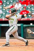 Josh Ludy #30 of the Baylor Bears follows through on his swing against the Houston Cougars at Minute Maid Park on March 4, 2011 in Houston, Texas.  Photo by Brian Westerholt / Four Seam Images