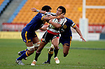 Koiatu Koiatu cops one under the chin from Pelu Pavihi during the Air NZ Cup game between Counties Manukau & Otago played at Mt Smart Stadium,Auckland on the 29th of July 2006. Otago won 23 - 19.