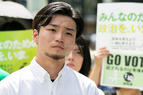 Aki Okuda leader of the Students Emergency Action for Liberal Democracy (SEALDs) attends a campaign event of the candidate Toshio Ogawa in Ginza shopping area on July 3, 2016, Tokyo, Japan. Yukio Edano secretary-general of the main opposition Democratic Party and Okuda offered their support to Ogawa's election campaign and called on young voters to participate in the House of Councillors elections. For the first time young citizens (18 and 19 year-olds) will be allowed to take part in the elections. (Photo by Rodrigo Reyes Marin/AFLO)