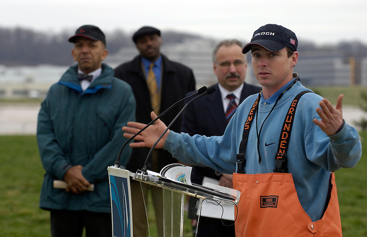 Chad Pregracke, founder of Living Lands & Water during a press conference on the cleanup of the Potomac and Anacostia Rivers. Mayor Anthony Williams is in the backgrounnd.
