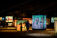 Parrtjima, a festival in Light, Alice Springs, Australia 2017. Pictured from L-R are local artists …. with (insert name of installation). September 22, 2017. James Horan Photography for Tourism NT