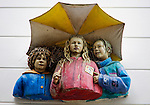 Sculpture of three children under umbrella artist John Ahearn, 1992, Boomgaardstraat, Rotterdam, Netherlands