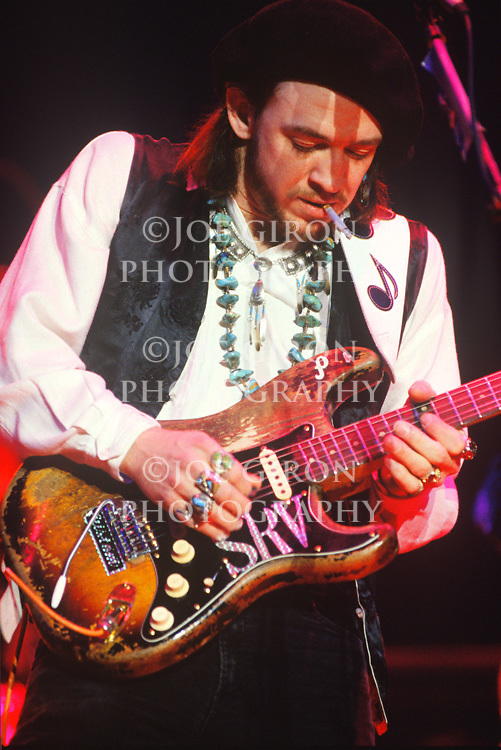 Live, in concert photograph of musical artist, Stevie Ray Vaughan