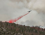 C-130 air tanker drops retardant on ridge above the Merced River at the South Fork Fire near Wawona  on August 14, 2017 in Yosemite National Park.  Photo by Al Golub/Golub Photography