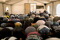 Men attend a tented mosque for Friday Prayers at Zaatari Refugee Camp. Approximately two million people have fled the conflict in Syria. At least 130,000 of them live in Zaatari Refugee Camp, although it was designed to house 60,000, and a further 2,000 people arrive each day.