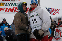 Patrick Mackey gets a hug from his dad before he leaves the start line of the 2009 Junior Iditarod on Knik Lake on Saturday Februrary 28, 2009.
