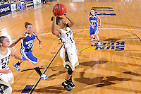 28 November 2010:  FIU player Rakia Rodgers (14) pulls down a rebound as FIU's Carmen Miloglav (24) and Indiana State's Taylor Whitley (23) and Anna Munn (33) watch in the first half as the FIU Golden Panthers defeated the Indiana State Sycamores, 68-47, to win the 16th annual FIU Thanksgiving Classic at the U.S. Century Bank Arena in Miami, Florida.