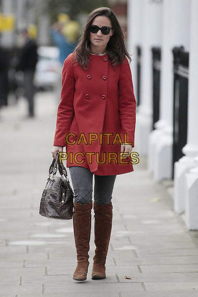 Pippa Middleton arrives for work, .London, England..November 29th, 2011.full length sunglasses shades red coat grey grey jeans denim brown boots suede bag purse .CAP/HIL.©John Hillcoat/Capital Pictures .