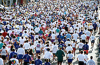 Rear view of a field of runners at the start of a race.