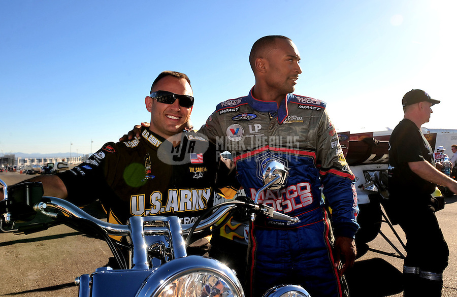 Apr. 13, 2008; Las Vegas, NV, USA: NHRA top fuel drivers Tony Schumacher (left) and teammate Antron Brown during the SummitRacing.com Nationals at The Strip in Las Vegas. Mandatory Credit: Mark J. Rebilas-