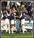 31/8/02       Collect Pic : James Stewart                     .File Name : stewart-falkirk v qots 17.COLLIN SAMUEL IS CONGRATULATED BY TEAM MATES AFTER SCORING THE THIRD....James Stewart Photo Agency, 19 Carronlea Drive, Falkirk. FK2 8DN      Vat Reg No. 607 6932 25.Office : +44 (0)1324 570906     .Mobile : + 44 (0)7721 416997.Fax     :  +44 (0)1324 570906.E-mail : jim@jspa.co.uk.If you require further information then contact Jim Stewart on any of the numbers above.........