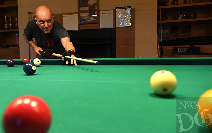 NWA Democrat-Gazette/J.T. WAMPLER John Blankenship of Fayetteville watches his shot while playing pool Monday August 5, 2019 in the pool room at the Fayetteville Senior Activity & Wellness Center. For more information about activities at the center visit www.fayetteville-ar.gov/305/Senior-Activity-Wellness-Center