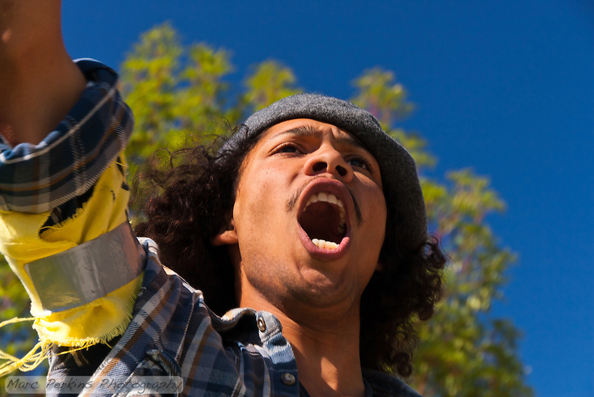 Dew-b Outlaw takes part in a chant during the Occupy Orange County, Irvine march on Saturday November 5.
