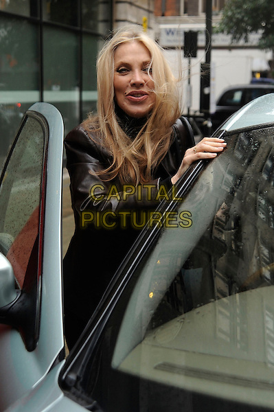 Singer / songwriter Lynsey De Paul has died at the age 64 following suspected brain haemorrhage. She represented the UK in the 1977 Eurovision Song Contest and was best known for her hits Sugar Me and Won't Somebody Dance With Me.<br /> STOCK PHOTO: LYNSEY DE PAUL <br /> Pictured in Great Portland Street,  London, England, UK,<br /> 26th October 2010.<br /> half length black brown leather jacket hand getting into car polo neck <br /> CAP/IA<br /> &copy;Ian Allis/Capital Pictures