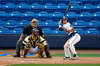 Canisius College Golden Griffins third baseman Liam Wilson (33) at bat in front of catcher Harrison Wenson (7) and umpire Robert Lothian during the first game of a doubleheader against the Michigan Wolverines on February 20, 2016 at Tradition Field in St. Lucie, Florida.  Michigan defeated Canisius 6-2.  (Mike Janes/Four Seam Images)
