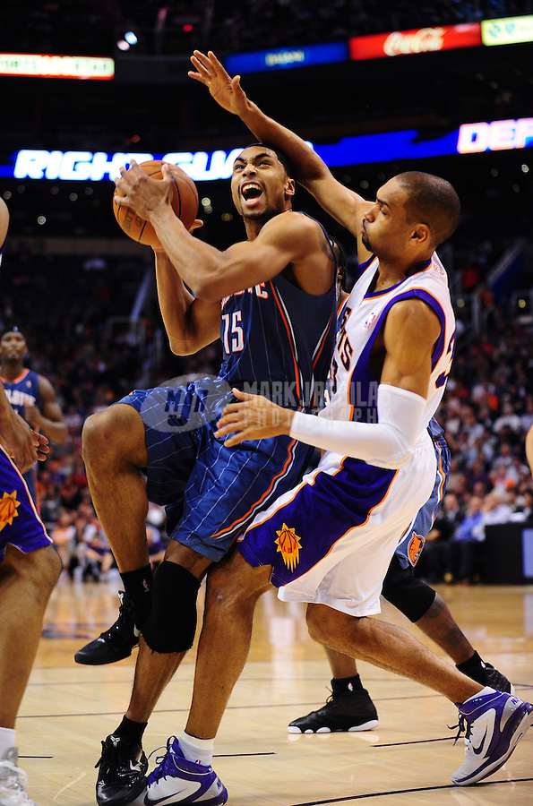 Jan. 26, 2011; Phoenix, AZ, USA; Charlotte Bobcats guard (15) Gerald Henderson drives to the basket against Phoenix Suns forward Grant Hill (right) in the first half at the US Airways Center. Mandatory Credit: Mark J. Rebilas-