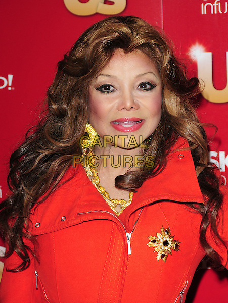 LA TOYA JACKSON.US Weekly's Hot Hollywood Party 2009 held at Voyeur, West Hollywood, California, USA. .November 18th, 2009.headshot portrait orange red LaToya gold necklace chunky earrings brooch.CAP/RKE/DVS.©DVS/RockinExposures/Capital Pictures.