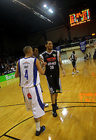 Saints guard Lindsay Tait shakes hands with Jon Rogers after the final whistle. NBL Semifinal - Wellington Saints v Bay Hawks at TSB Bank Arena, Wellington on Friday, 25 June 2010. Photo: Dave Lintott/lintottphoto.co.nz