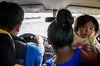 Passengers, including a mother and her baby son, travel in a cab towards a Sunday market in Eterazama town, Chapare region, Bolivia. December 01, 2019.<br /> Des passagers, dont une mère et son bébé, voyagent en taxi vers un marché dominical à Eterazama, dans la région du Chapare, en Bolivie. 01 décembre 2019.